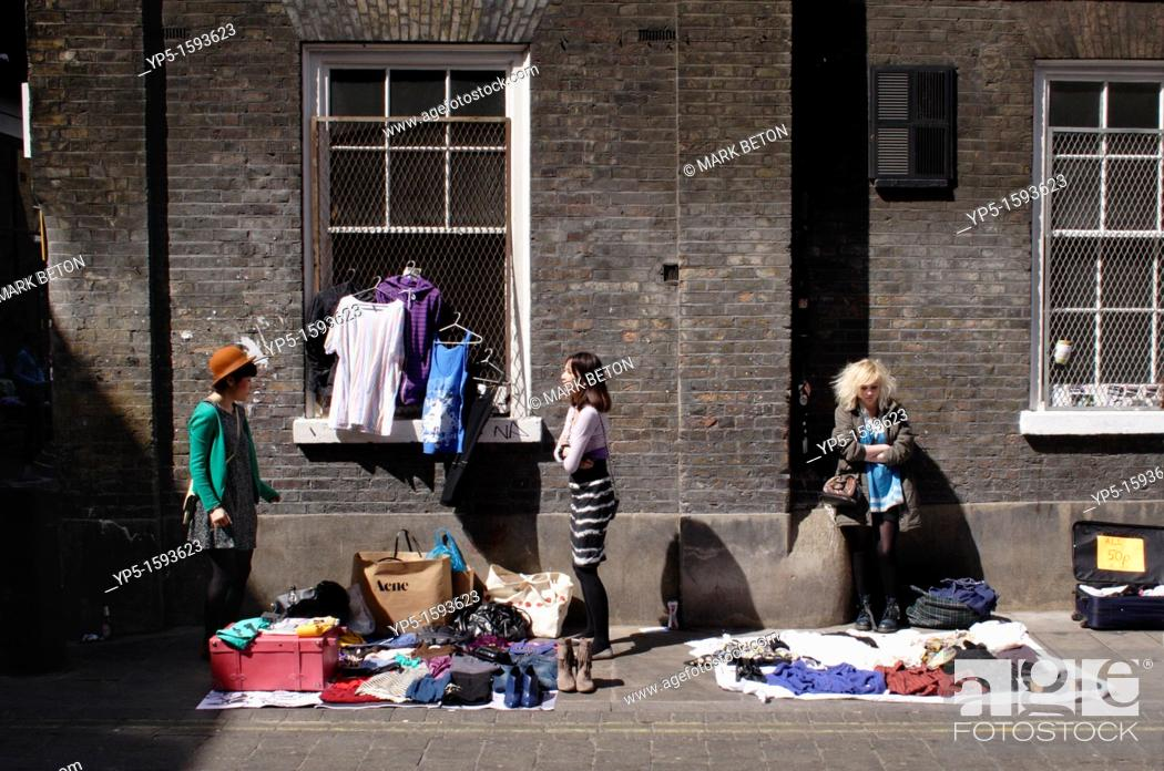 Stock Photo: Traders selling their wares at Brick Lane Market London.