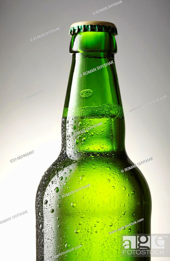 Stock Photo: Green bottle of beer close-up.
