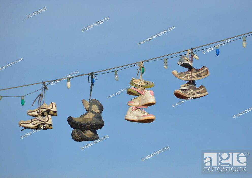 Stock Photo: shoes hanging on power line, New Mexico.