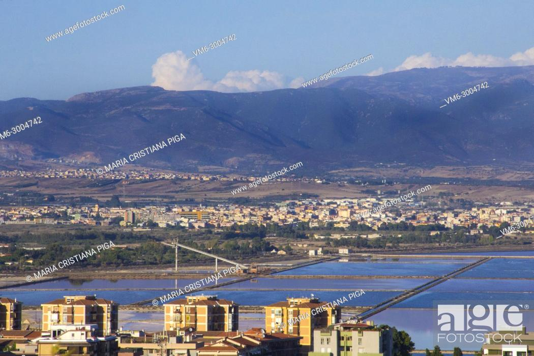 Stock Photo: View of Cagliari, Italy, and nearby villages with the salt flats in the foreground.