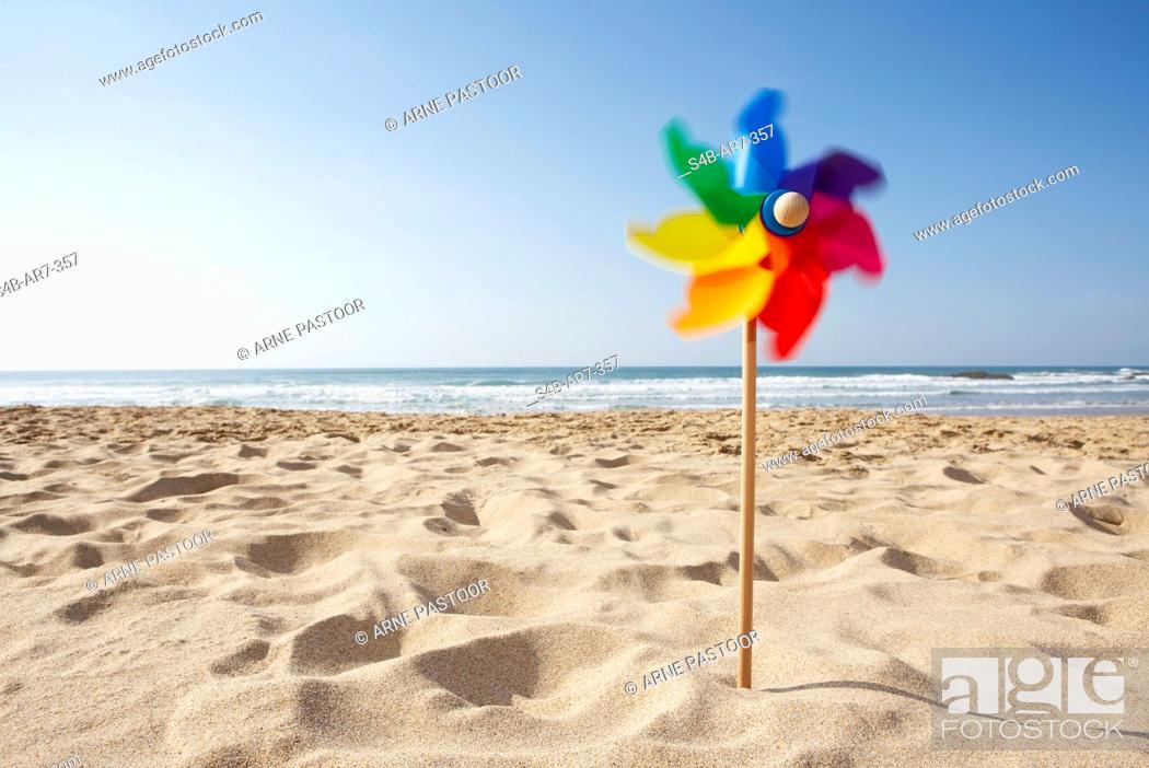 Stock Photo: Pinwheel on the beach, Odeceixe, Algarve, Portugal.
