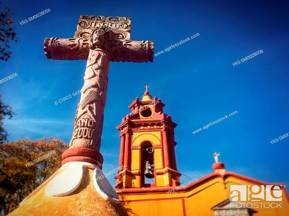 Stock Photo: A Cruz Florida (flowery cross) decorates the entrance of the San Sebastian church in San Sebastian Bernal, Queretaro State, Mexico.