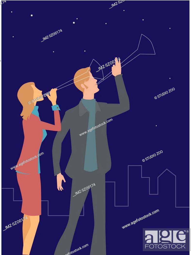 Stock Photo: A man and woman blowing noise makers at night.