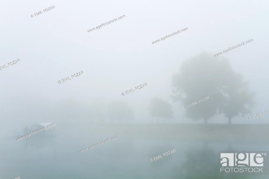 Stock Photo: A moored vessel in foggy morning.