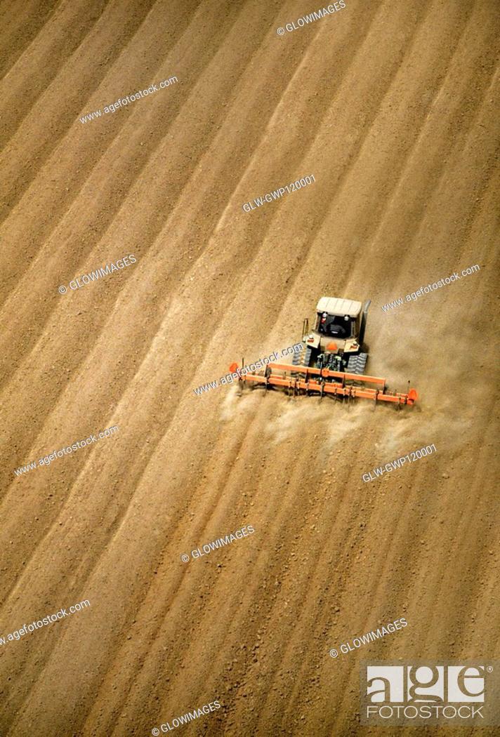 Stock Photo: Aerial, plowing farm field.