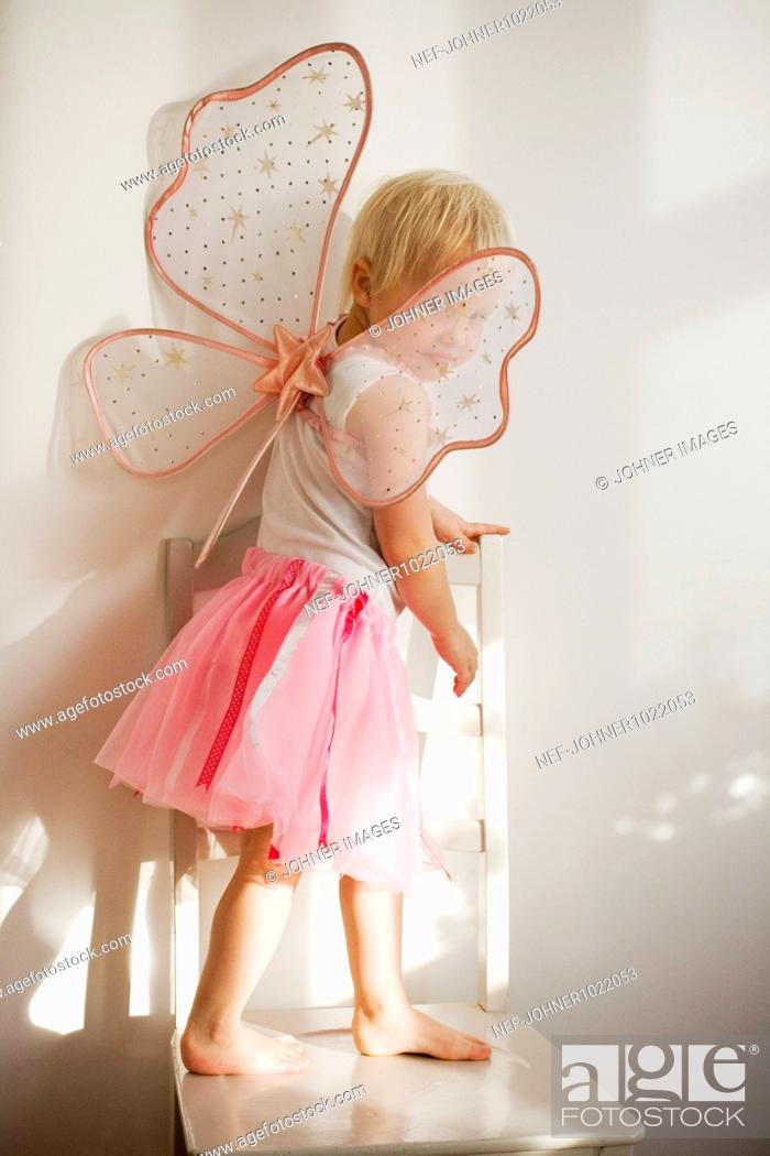 Stock Photo: Sweden, Skane, girl (4-5) wearing fairy costume.