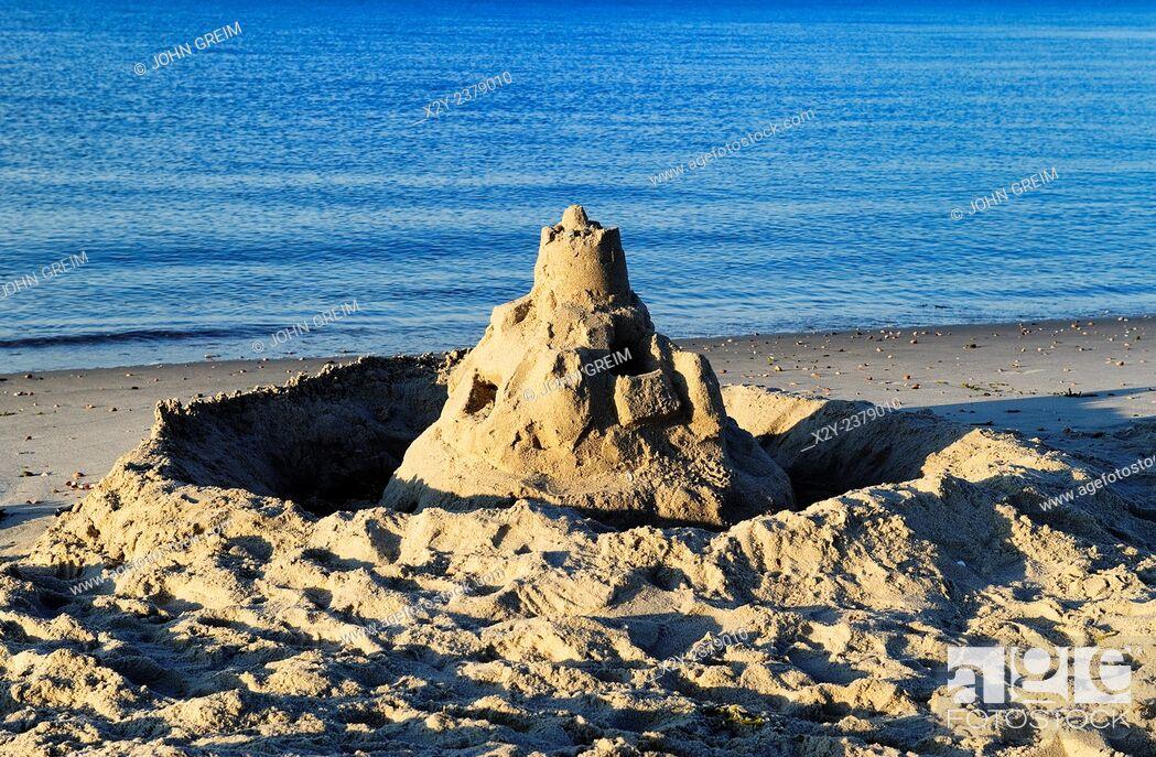 Stock Photo: Sand castle along the ocean edge, Cape Cod, MA, USA.