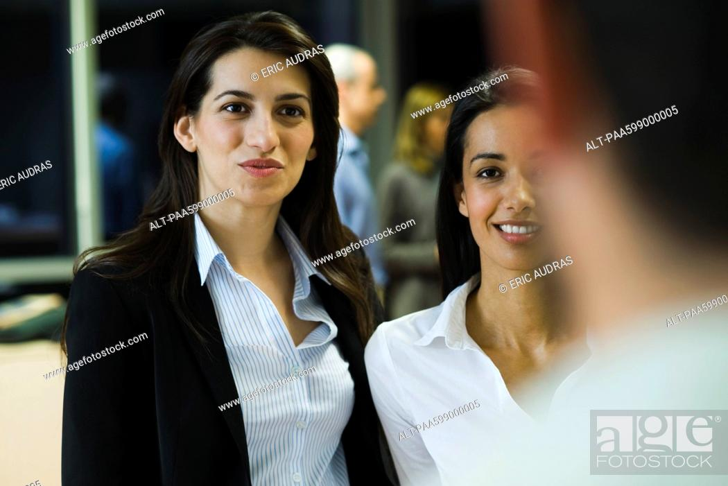 Stock Photo: Colleagues talking in office.