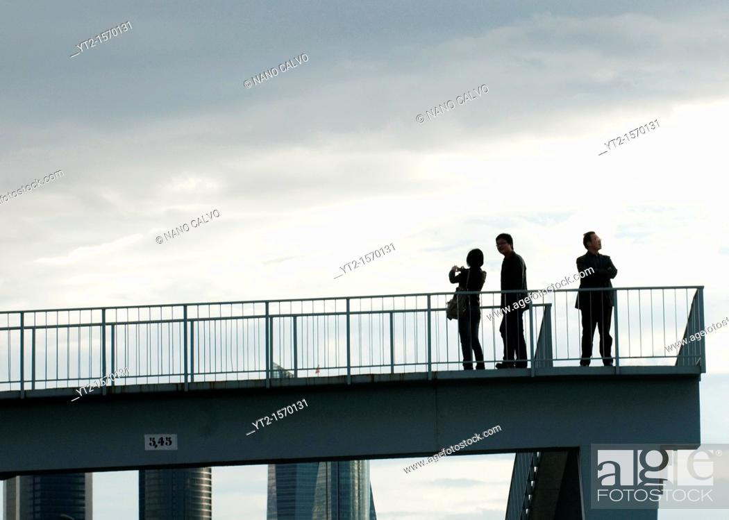 Stock Photo: Tourists taking photos of CTBA towers, a business park near Paseo de la Castellana in Madrid Originally known as Madrid Arena.