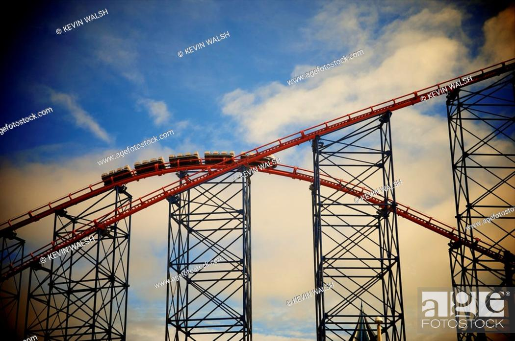 Stock Photo: Big One roller coaster on Blackpool Pleasure Beach morning testing under stormy sky.