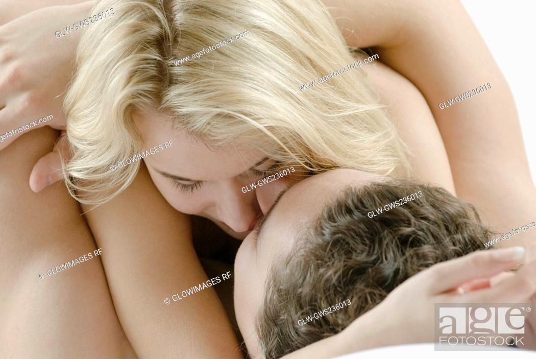 Stock Photo: Close-up of a young couple romancing on the bed.