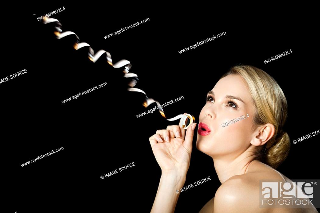 Stock Photo: Young blonde woman with party streamer.