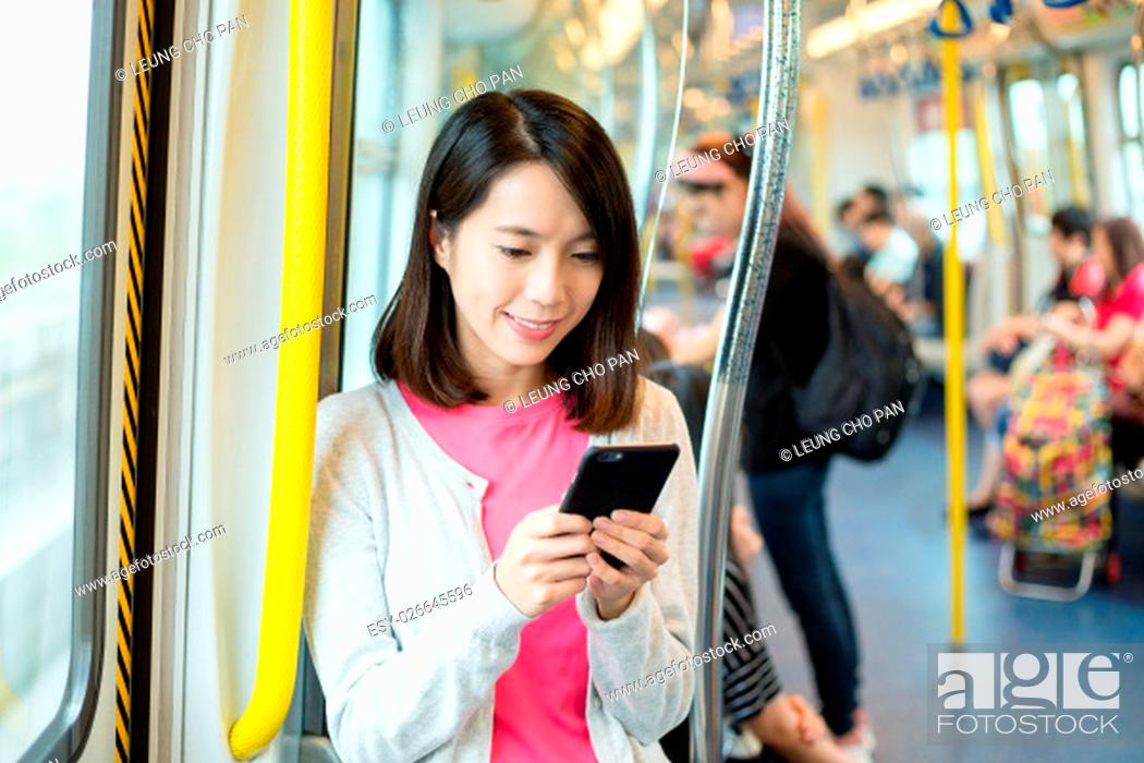 Stock Photo: Woman use of mobile phone in train compartment.