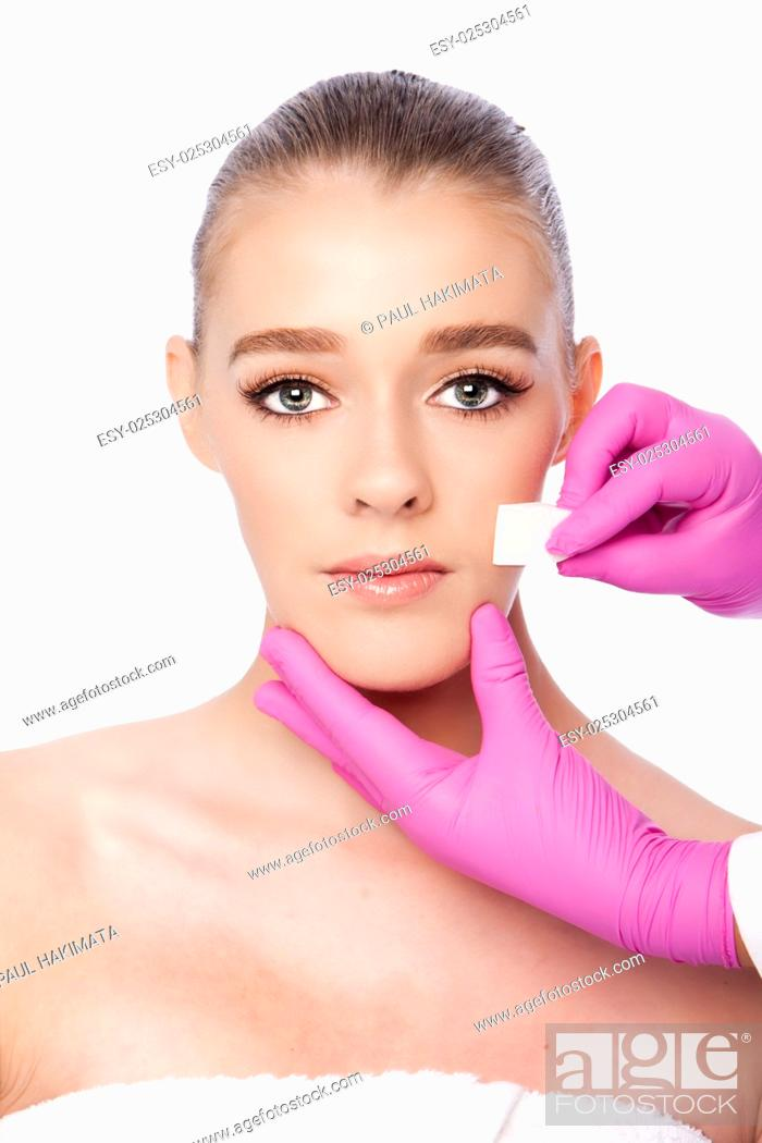 Stock Photo: Beautiful face cleansing Cosmetic skincare spa beauty treatment with pink gloves and sponge, on white.