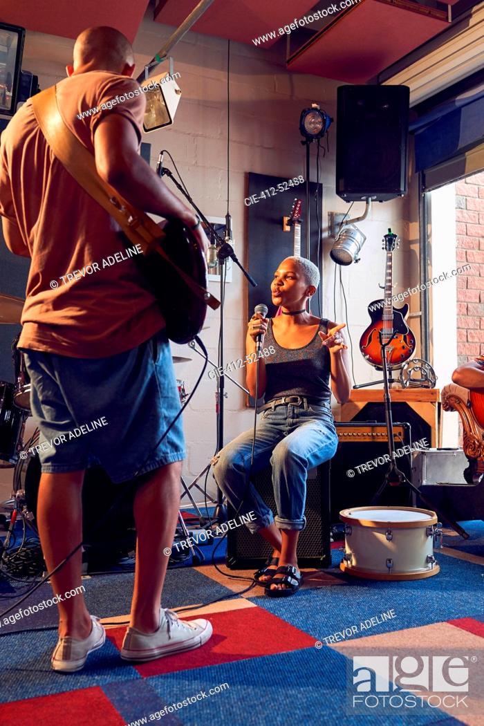 Stock Photo: Musicians practicing in recording studio.