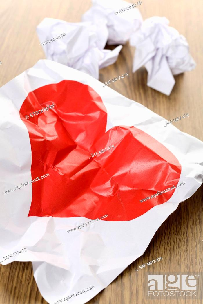 Stock Photo: Red heart on a crumpled paper.
