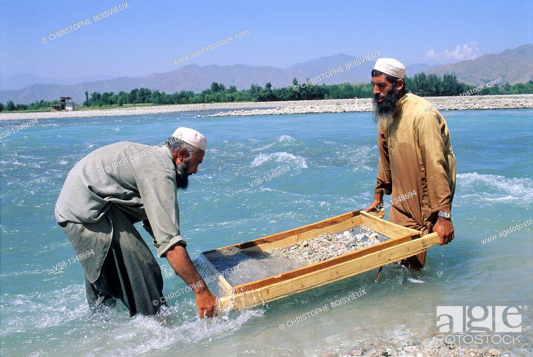 Stock Photo: Pakistan, Mingora region, Swat river, Men panning for gold.