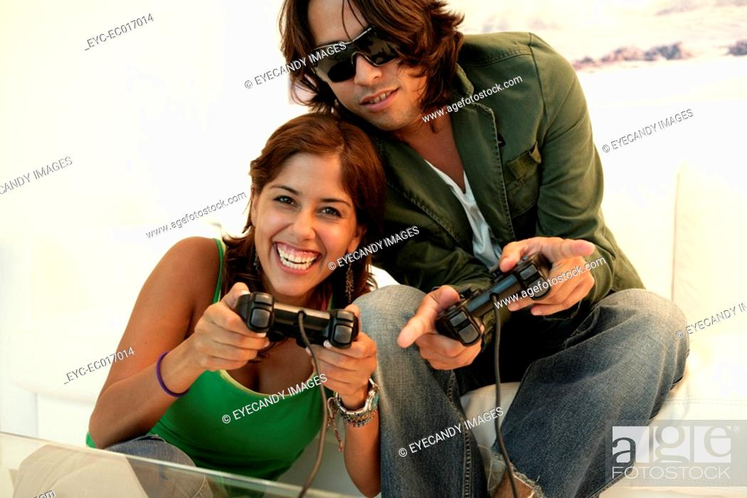Stock Photo: View of a couple playing video game.