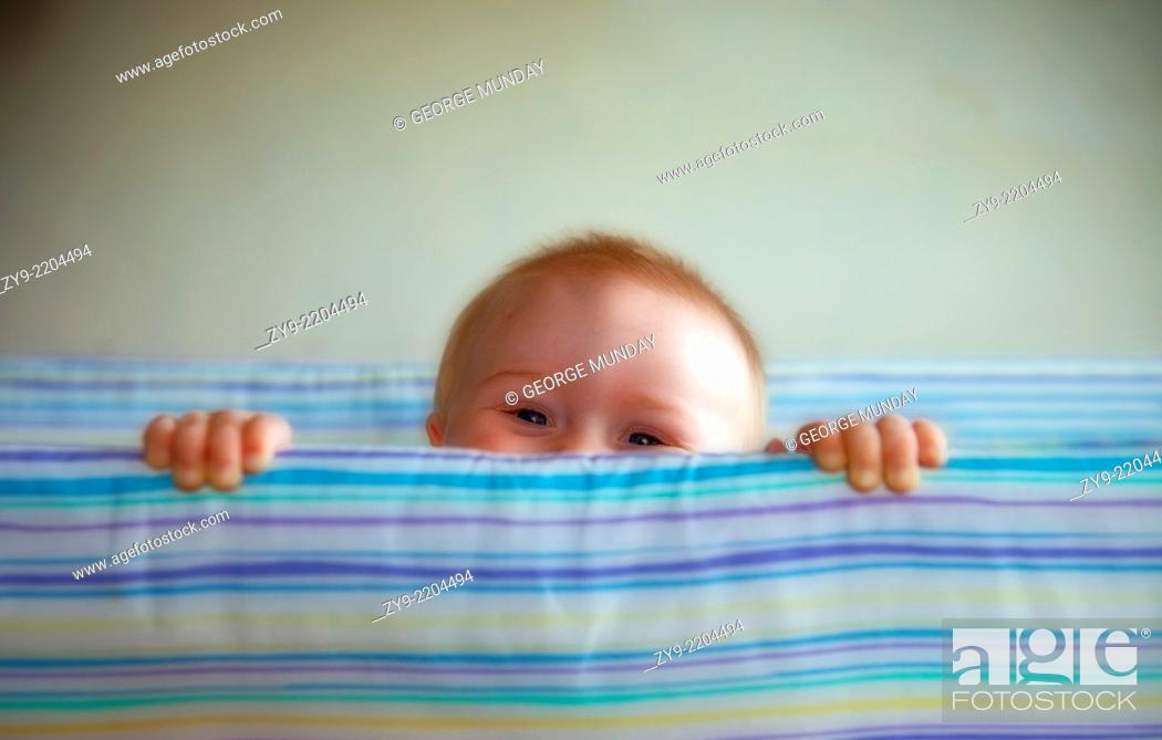 Stock Photo: Young Toddler in Cot,.