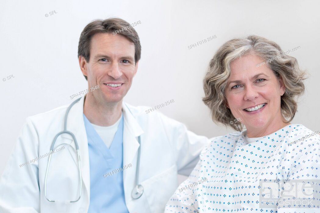 Stock Photo: Male doctor and female patient smiling towards camera.