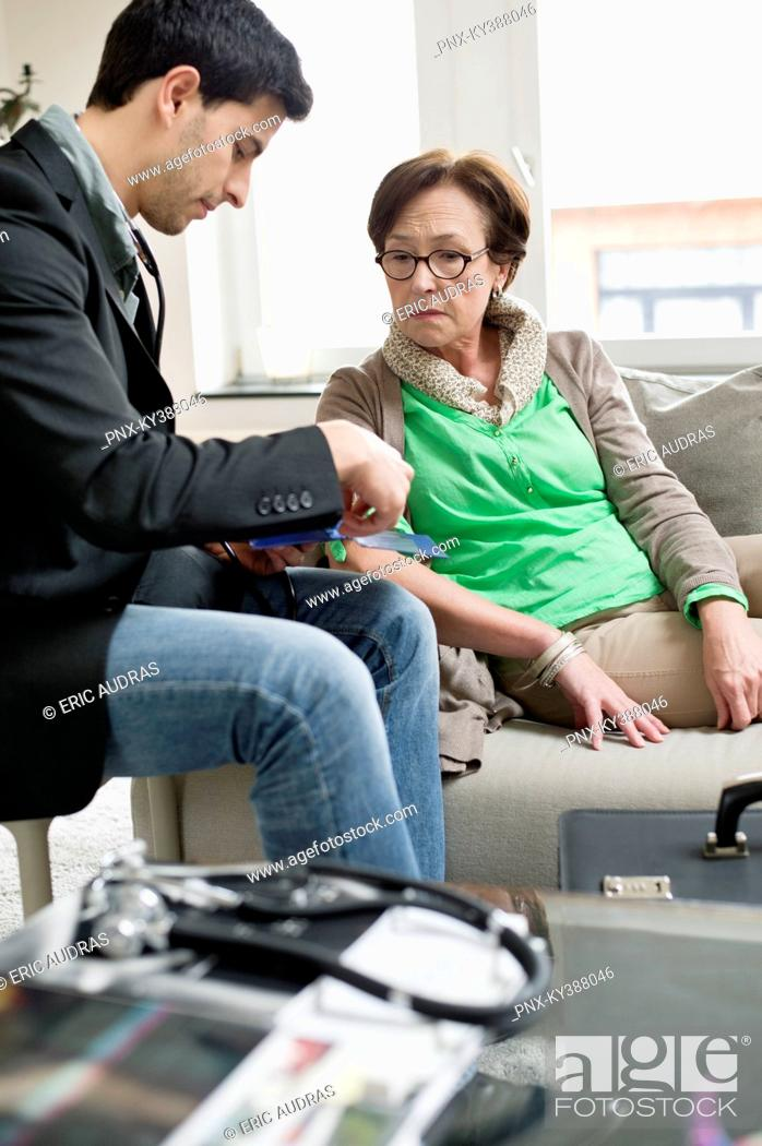 Stock Photo: Male doctor examining a patient.