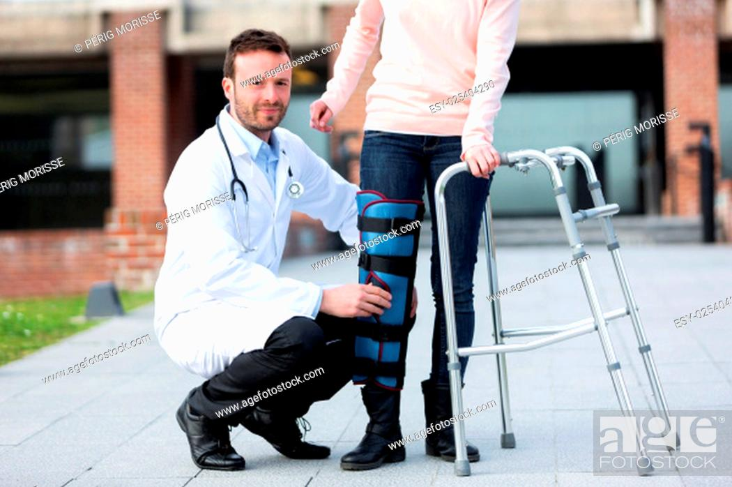 Stock Photo: View of a Young doctor assisting a young woman.