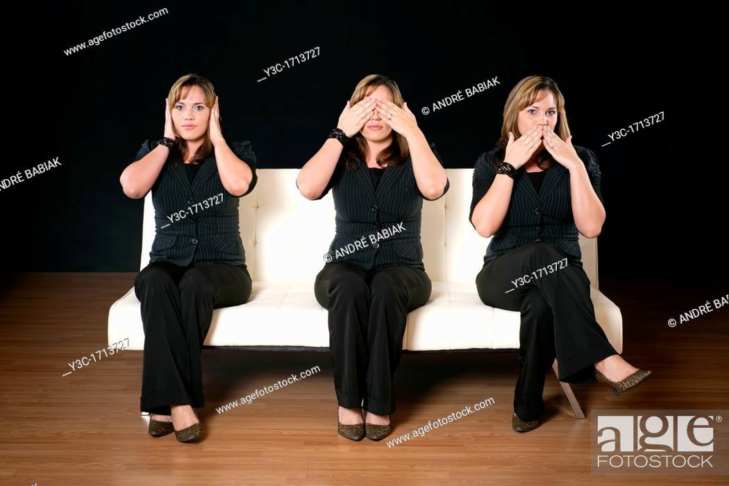 Stock Photo: Three women - see no evil, hear no evil, speak no evil.