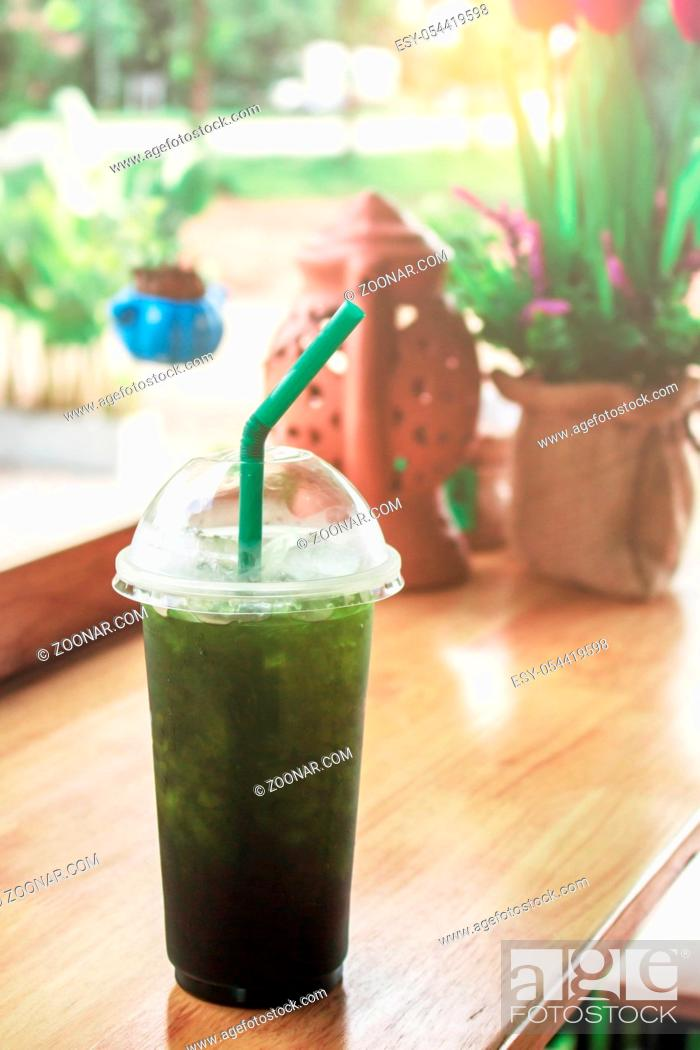 Stock Photo: Green tea glass on wooden table in restaurant.