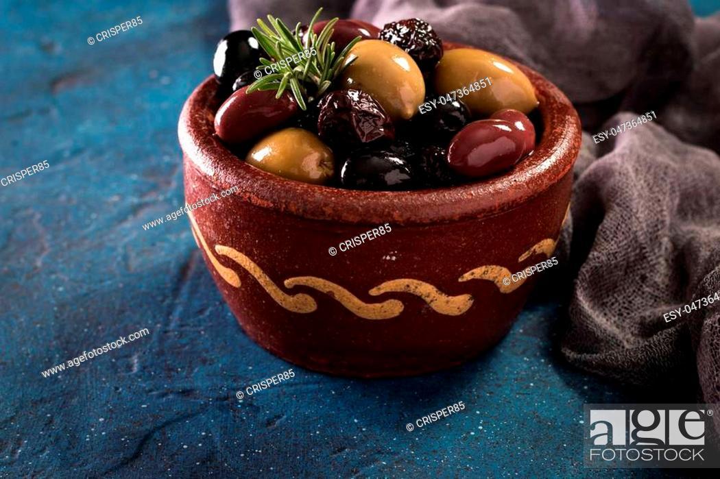 Stock Photo: bowls with different kind of olives green olives, black olives, kalamata olives on table.