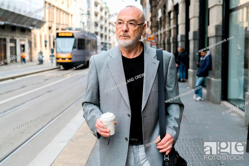 Stock Photo: Businessman in city, Milan, Lombardia, Italy.