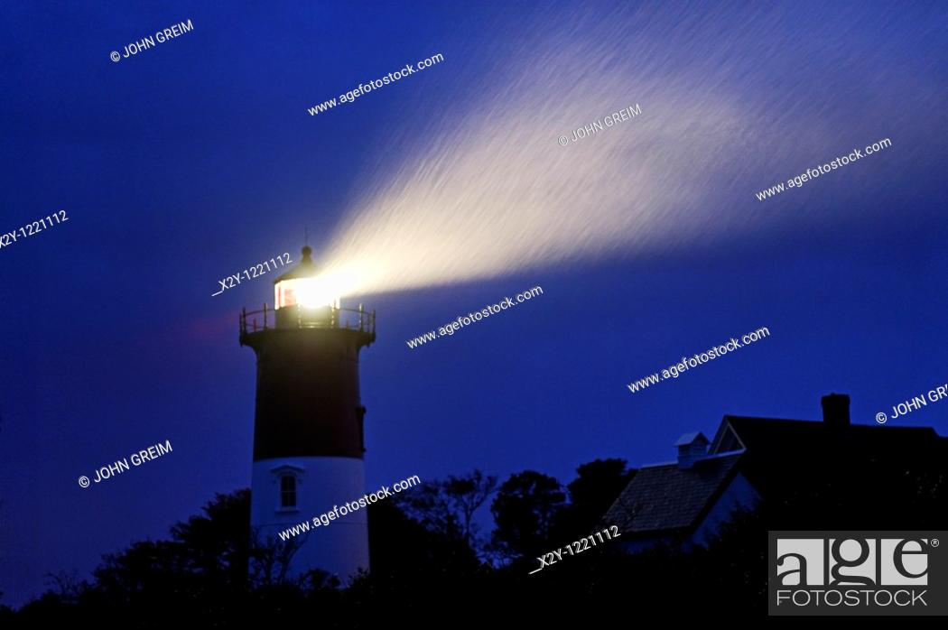 Stock Photo: Nauset Light shines during a stormy night, Cape Cod National Seashore, Eastham, Cape Cod, MA, USA.