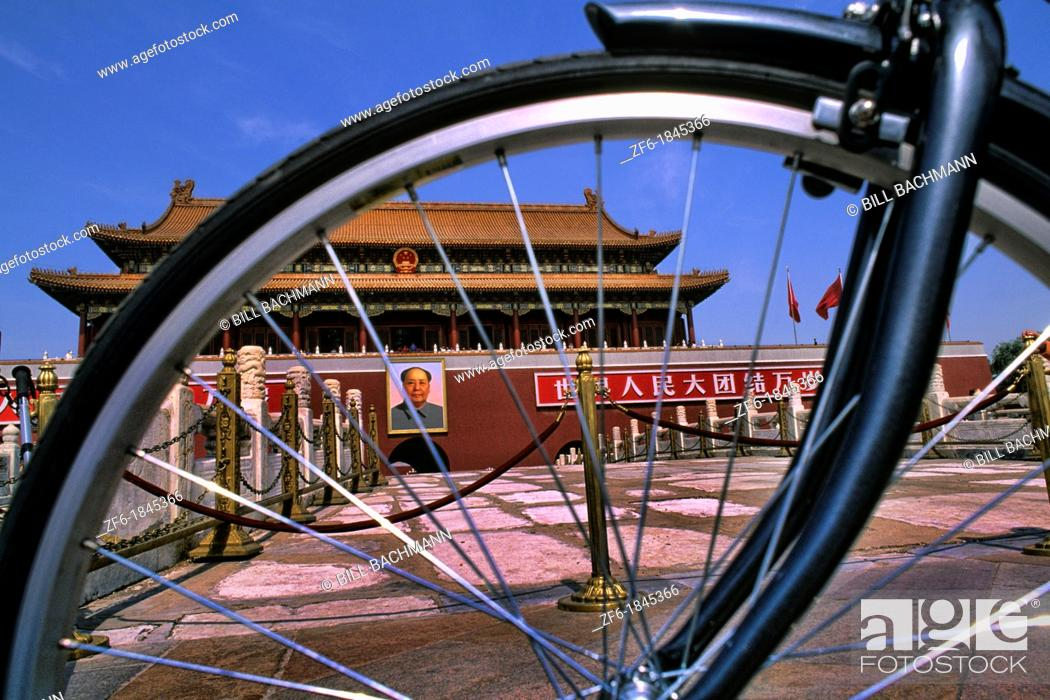 Imagen: Graphic image of bike and Mao portrait at Heavenly Gate in Beijing China.