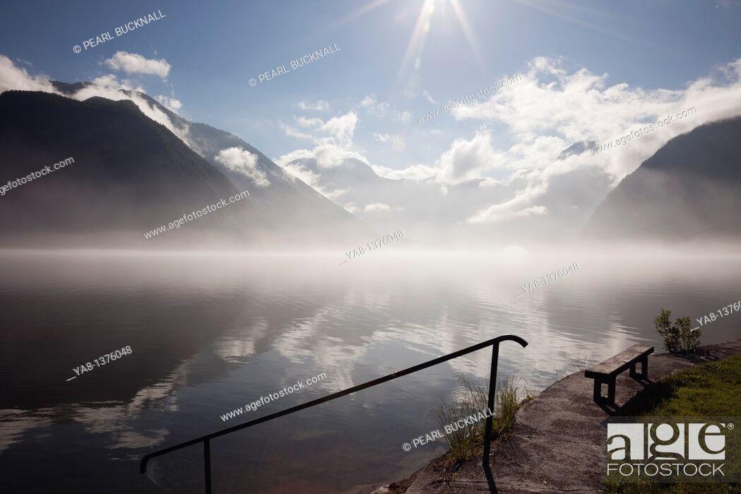 Stock Photo: Hallstatt, Salzkammergut, Austria, Europe  View across Hallstattersee Lake with morning mist rising in the Austrian Alps.