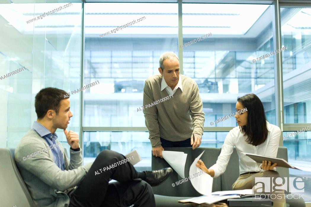 Stock Photo: Colleagues discussing work.