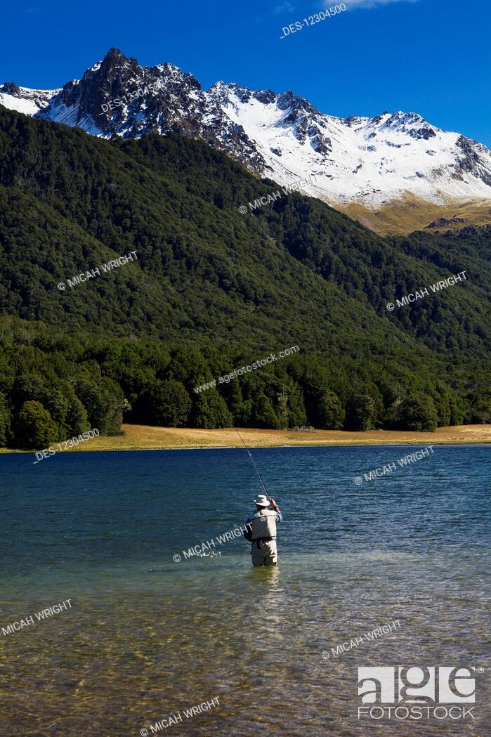 Imagen: A man practices fly fishing at Mavora Lake; Mavora, Southland, New Zealand.