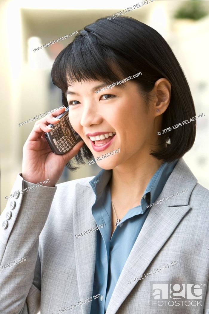 Stock Photo: Asian businesswoman talking on cell phone.