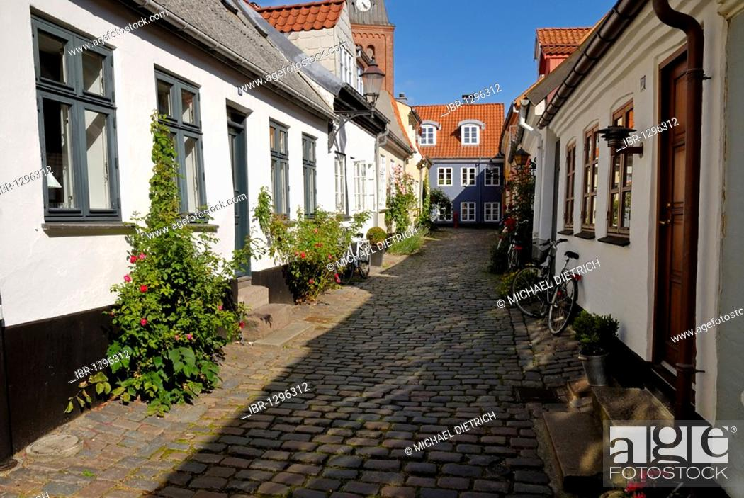 Stock Photo: Cobblestone street in the historic town of Aalborg, Ålborg, Nordjylland region, Denmark, Scandinavia, Europe.