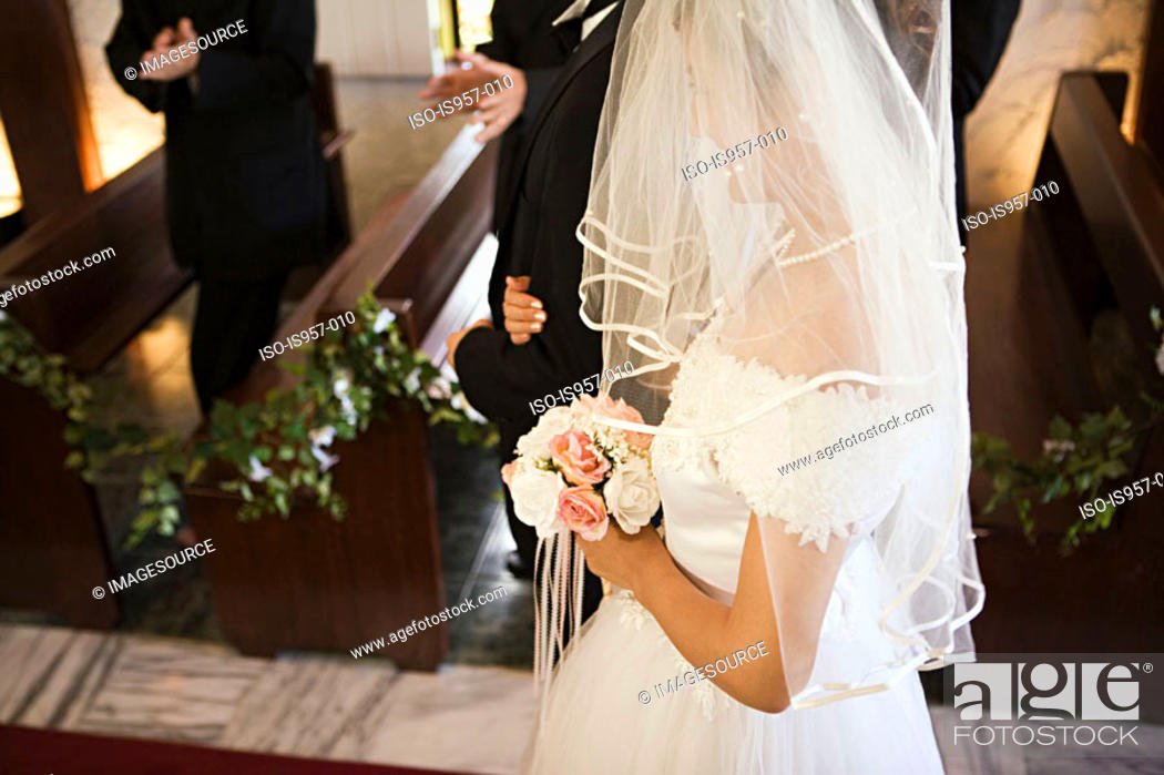 Stock Photo: Bride and groom in church.