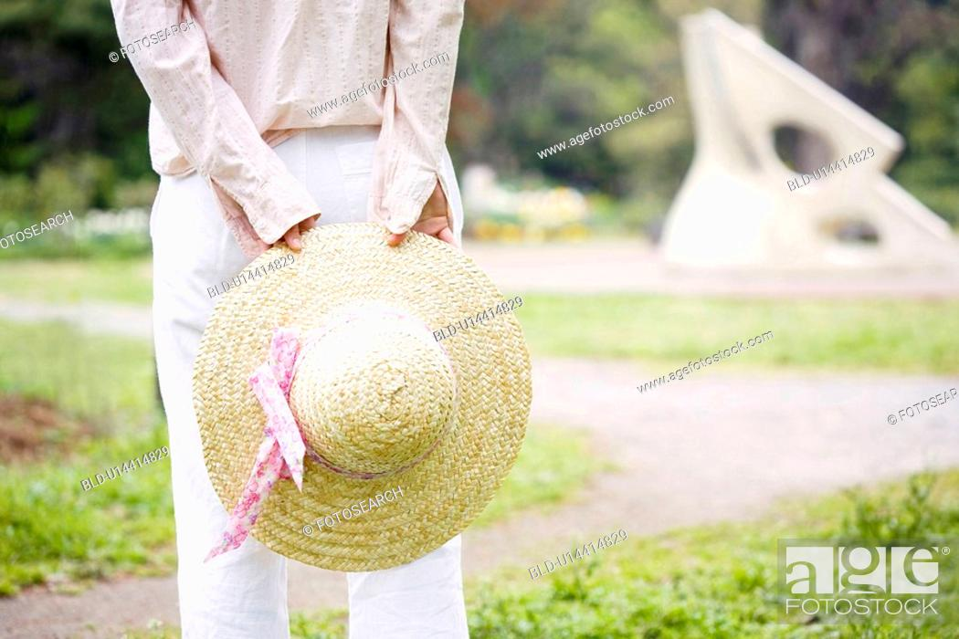 Stock Photo: Straw hat and woman.