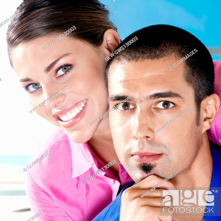 Stock Photo: Portrait of a businesswoman and a businessman smiling.