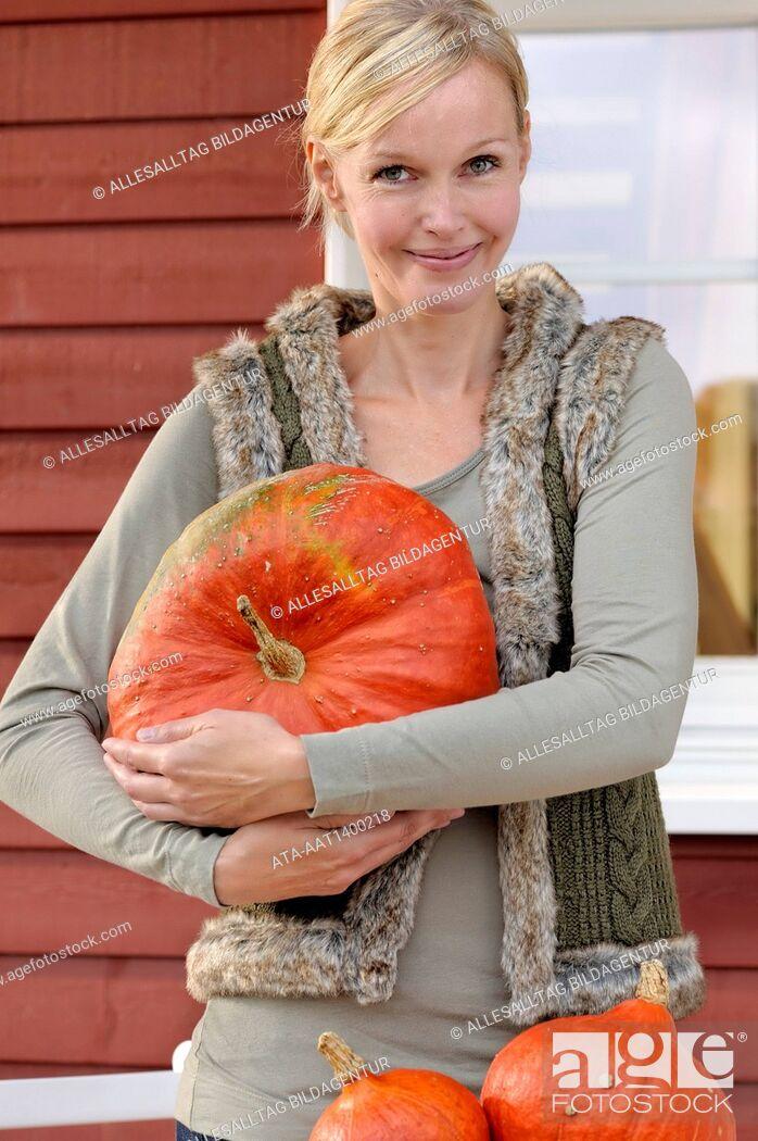 Stock Photo: Woman with Hokkaido pumpkins.