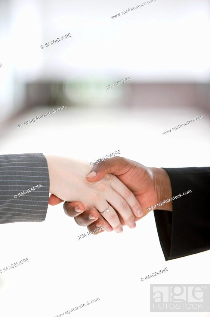 Stock Photo: Close-up of handshake of different ethnic people.