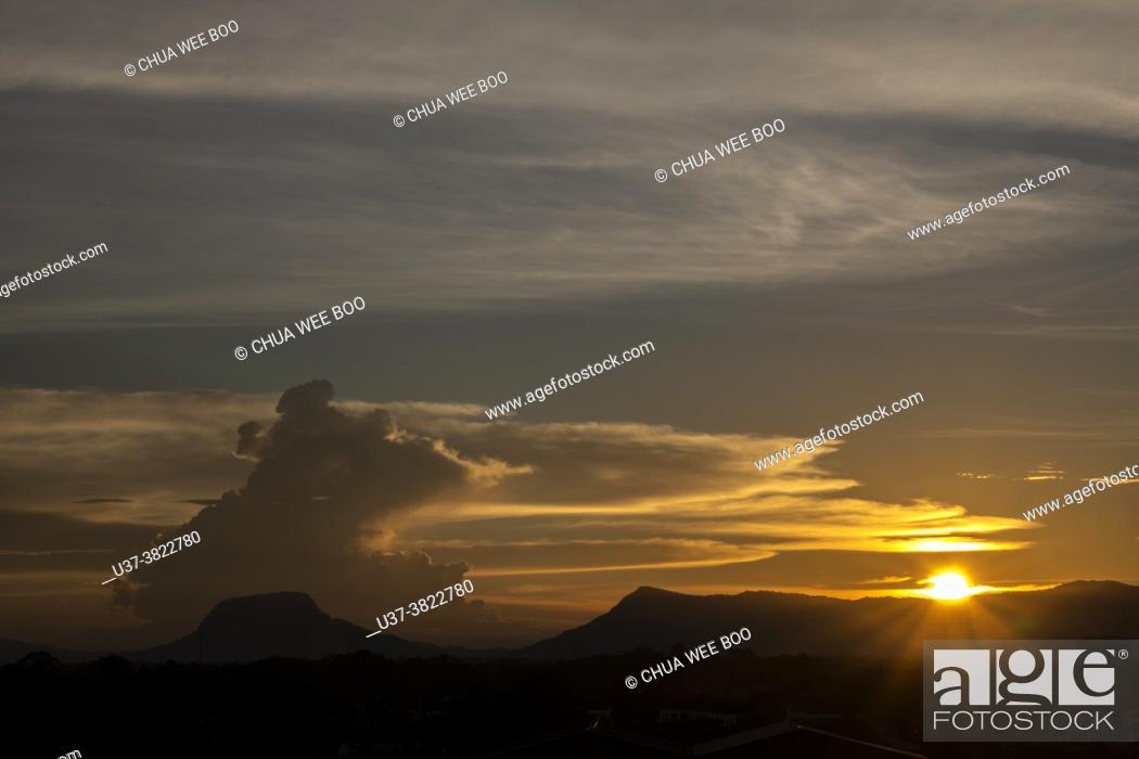 Stock Photo: Dusk at Gunung Serapi, Matang, Sarawak, East Malaysia.