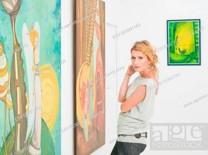 Stock Photo: beautiful woman visiting an art gallery.
