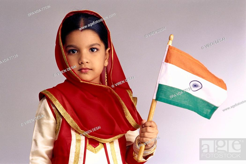 dd642589bd Stock Photo - Child dressed as Sikh Girl Wearing Traditional Punjabi Dress  ; Holding The Indian Flag MR 497