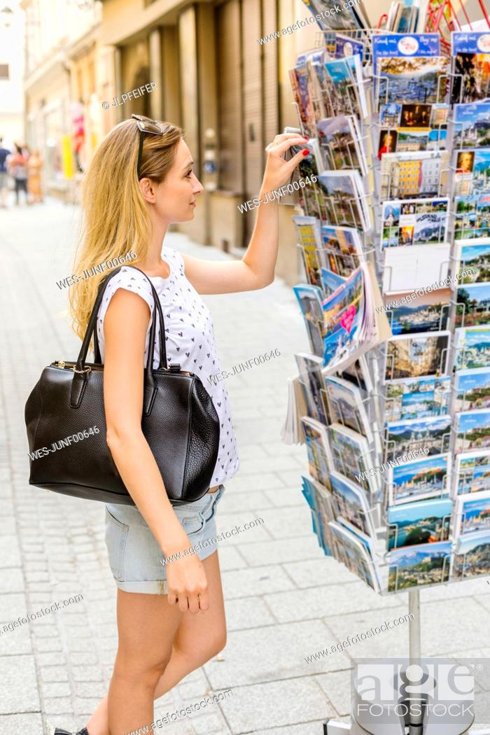 Stock Photo: Austria, Salzburg, tourist choosing post cards.
