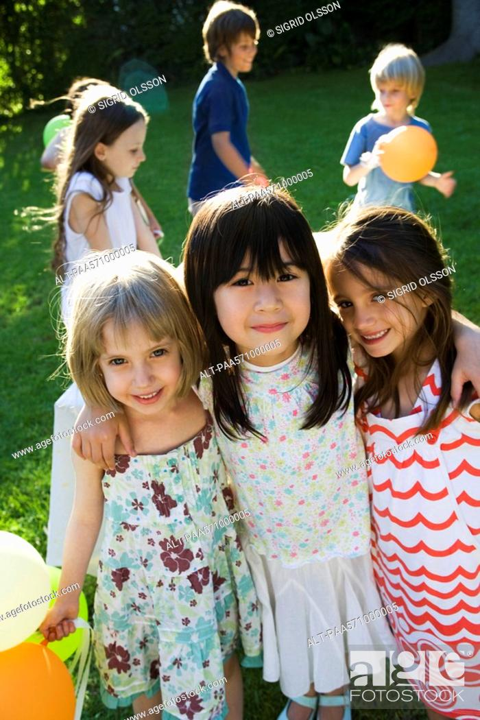 Stock Photo: Childhood friends at outdoor party, portrait.
