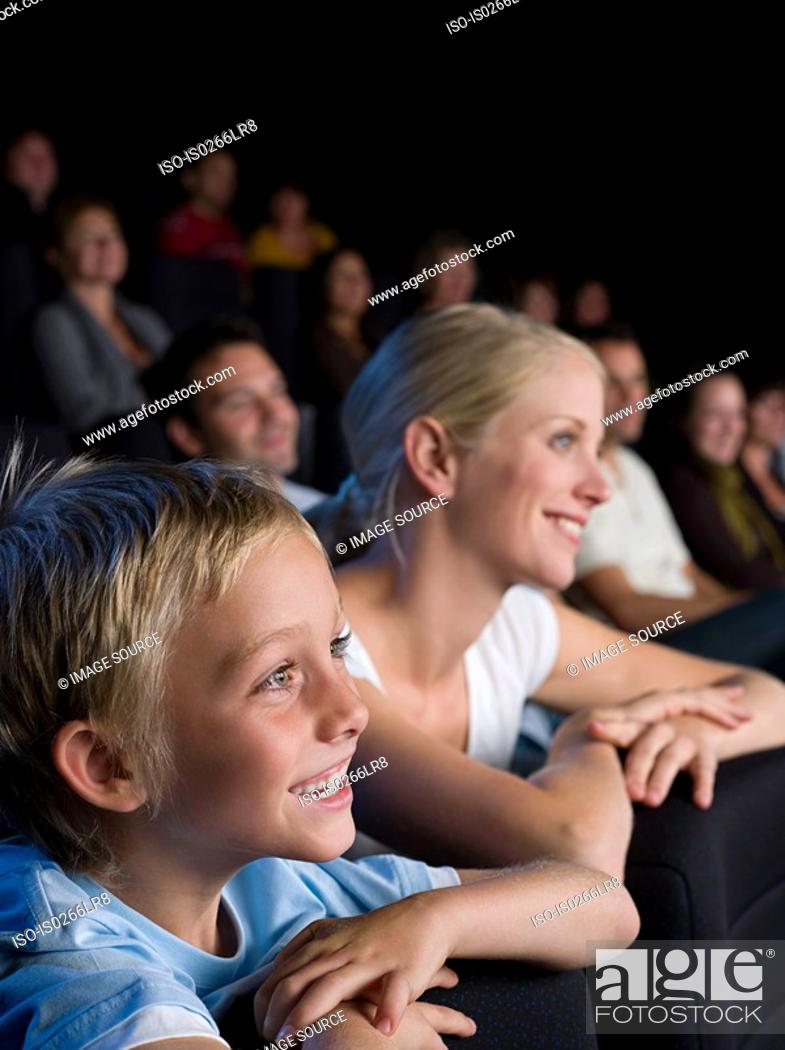 Stock Photo: A mother and son watching a movie.