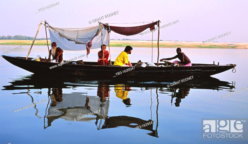 Stock Photo: Tourists take a boat trip on the River Ganges, Varanasi, Uttar Pradesh, India.