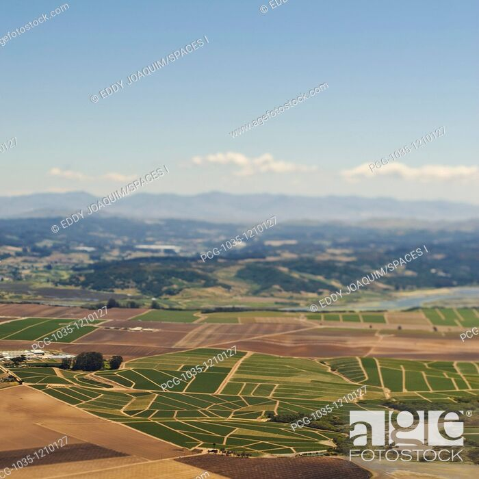 Stock Photo: Farmland and Mountains in the Distance.